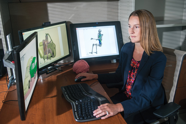 Ashley Weaver, an assistant professor at the Virginia Tech-Wake Forest University Center for Injury Biomechanics, examines a crash simulation with LS-DYNA.