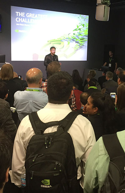 NVIDIA CEO Jen-Hsun Huang addresses SC16 attendees from the company's booth on the show floor.